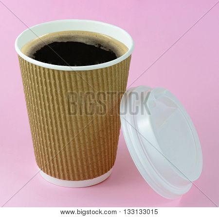 Coffee in brown  take away cup on pink background
