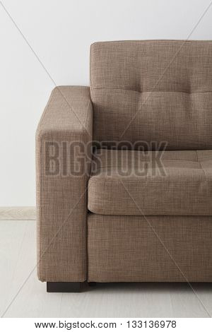 Brown sofa isolated against the white wall