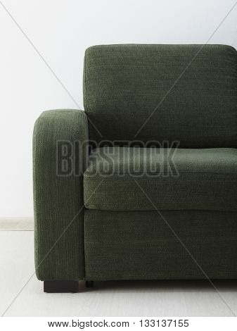 Grey sofa isolated against the white wall