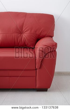 Red Leather Sofa Against The Wall