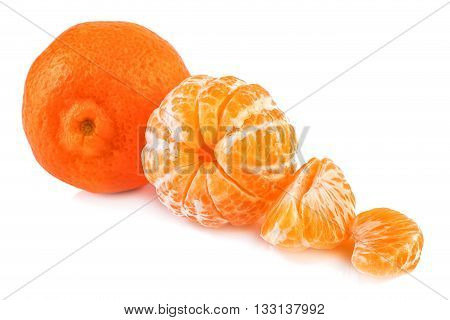 Tangerine and peeled tangerines on white background. Closeup.