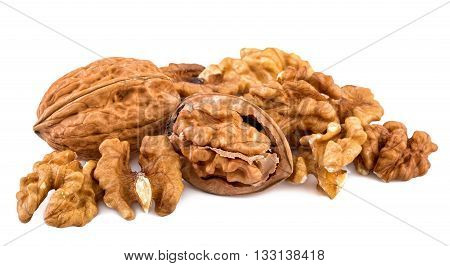 Walnuts and shelled walnuts on white background.