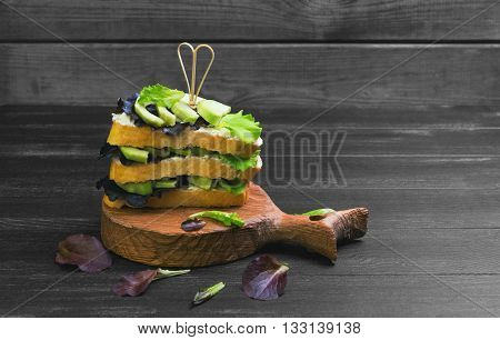 High Large Layered Sandwich With Avocado
