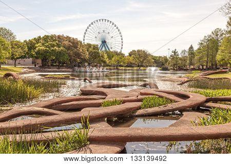 DALLAS USA - APR 8: Saggitaria Platyphylla statue by Patricia Johanson at the Leonhardt Lagoon of the Fair Park in Dallas. April 8 2016 in Dalls Texas United States