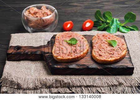 Two Sandwiches On Loaf Of Bread With Meat Pate