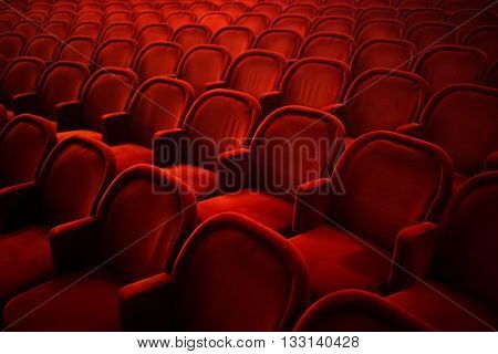 Rows of empty red seats in cinema or theater