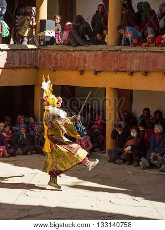 Korzok,India - July 23, 2012: unidentified monk in deer mask with sword performs religious mystery dance of Tibetan Buddhism during the Cham Dance Festival in Korzok monastery, India.
