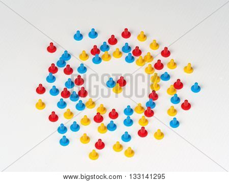 Illustration of a group singled out by colored plastic board game hats in various colors