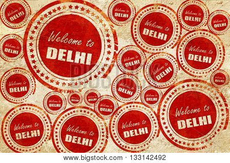 Welcome to delhi, red stamp on a grunge paper texture