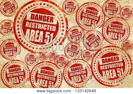 area 51 sign, red stamp on a grunge paper texture