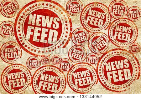 news feed, red stamp on a grunge paper texture