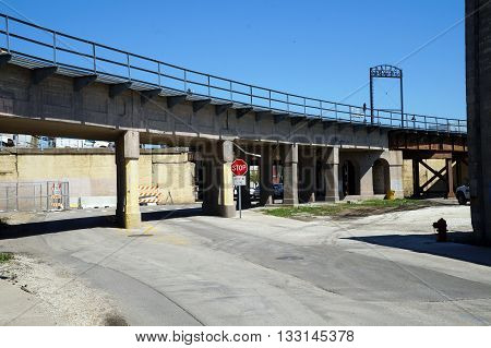 A stop sign tells motorists to stop at a line when driving through a railroad underpass on York Avenue in downtown Joliet.