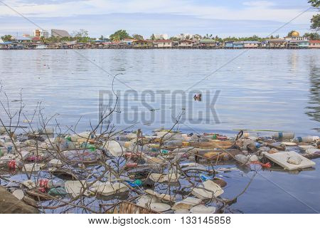 KOTA KINABALU, MALAYSIA - 05 JUNE 2016: Plastic bottles and bags pollution in ocean. Shows the importance of recycling and care for environment.