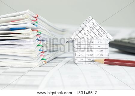 House With Pencil And Overload Of Paperwork On Finance Account