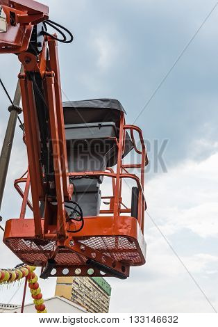 Oragne basket of the hydraulic crane for maintenance the electric pole.