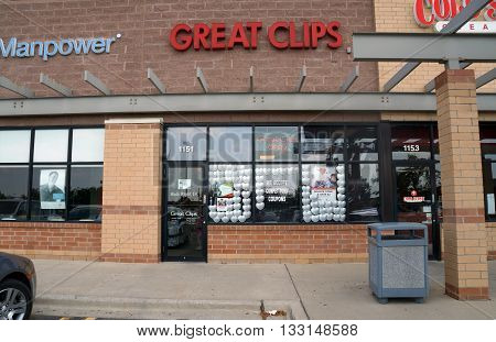 SHOREWOOD, ILLINOIS / UNITED STATES - AUGUST 16, 2015: One may have one's hair cut at Great Clips, in a strip mall in Shorewood.