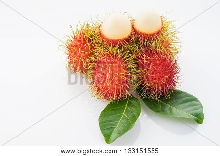 a lot of rambutan fruit isolated on white background