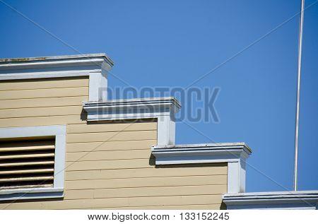 Yellow geometric wall on a building in a town on Kitsap peninsula Washington