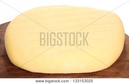 Homemade cheese on wooden board