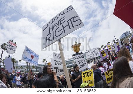SAN DIEGO USA - MAY 27 2016: The Trump rally in San Diego attracts a huge crowd of protesters many of them carrying pro-immigrant signs such as this sign reading