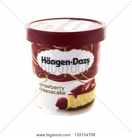 SWINDON UK - JUNE 3 2016: Tub of Haagen-Dazs iStrawgerry Cheescake ce cream on a white background