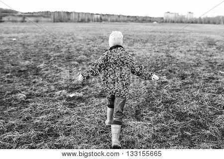 Happy Child Playing Outdoors.
