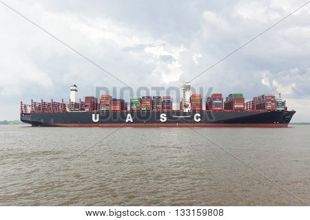 Stade, Germany - May 23, 2016: Ultra large container ship Barzan on the Elbe river near Hamburg. With 400 meters overall length it is among the largest container ships in the world