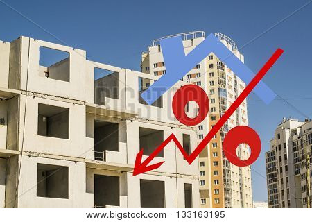 Red percent sign on the background of construction