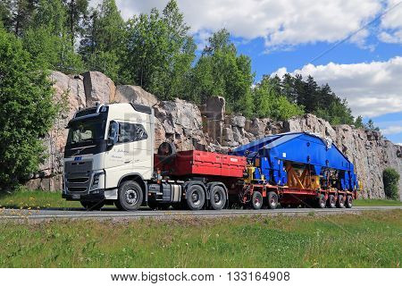 PAIMIO FINLAND - JUNE 4 2016: Volvo FH16 750 semi transports shipyard crane component. The 48-tonne load is supported by 24 wheels.