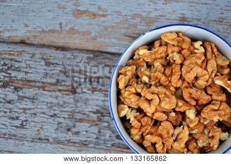 Walnut Kernels In Cup Organic Tree Harvest Blue Wood Texture 4