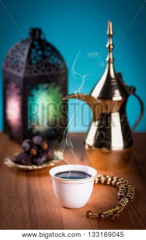 Arabian coffee with dates and Ramadan lantern