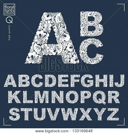 Set of vector ornate capitals flower-patterned typescript. Black and white characters created using herbal texture.