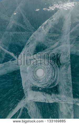 Ice ax - ice screws on winter fishing on the ice caves. Ice is very clean and beautiful. The Lake Baikal.