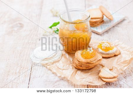 Fresh juicy jam with figs in a jar with crackers and cottage cheese for breakfast horizontal with copy space