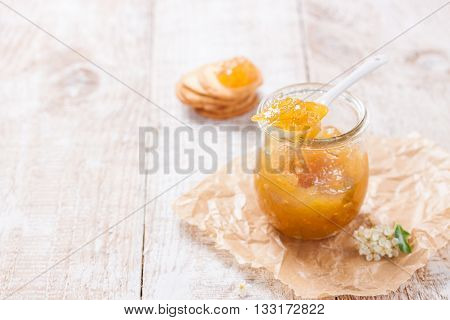Fresh juicy fruity jam with figs in a jar with crackers and cottage cheese for breakfast horizontal with copy space