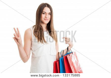 Fashion Woman Portrait With Young Shopaholic Showing Victory Sign