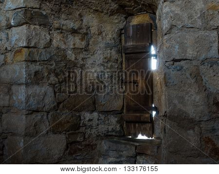 .dark Room With Stone Walls And Window .