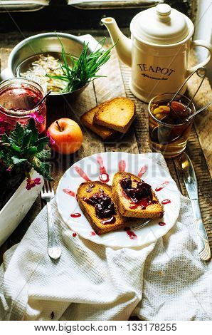 Toast With Jam And Cup Of Tea On Old Wooden Table. Delicious Toa