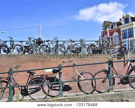 Bicycles in Amsterdam city. Urban scene with bicycles in a row.