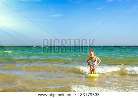 Cute Girl In Swimsuit Bathes On Waves In Sea. Sunny Mediterranea