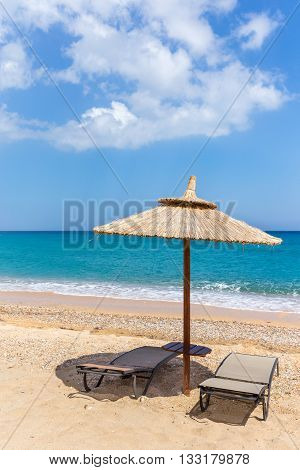 One parasol and sun beds and parasol at sea