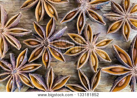 Anise stars on wooden brown background. Macro shot