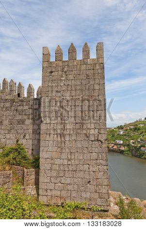 Tower of city rampart in Porto (UNESCO site). Walls were completed in 1370 in the reign of King Ferdinand I so usually called Ferdinand Walls (Muralha Fernandina)