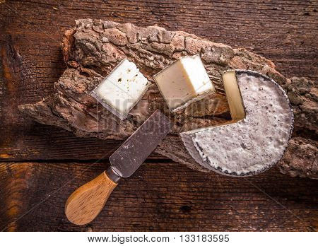 Top view of french camembert cheese on wooden background