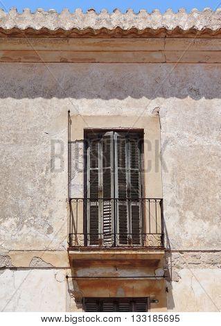 old, run down facade of an historic house