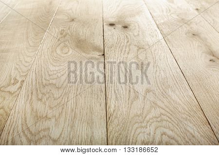 Unpainted oak wood texture and background. Timber oak flooring, wood texture background. Natural wooden background. Unpainted wood planks texture pattern. Wooden surface.