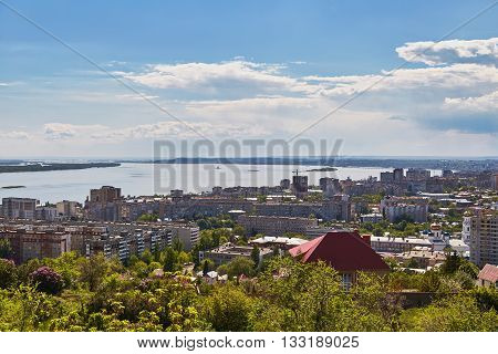 The beautiful blue sky with clouds over the town Saratov