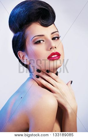 young girl with perfect make-up in photo studio