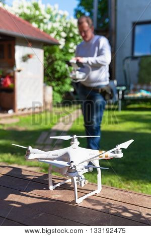 St. Petersburg Russia - May 4 2016: Drone quadrocopter Phantom 3 Professional with high resolution digital camera designed by the Chinese company DJI stands on a wooden floor selective focus