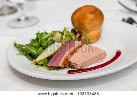 A Pate and Arugula Salad on plate